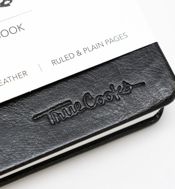 TrueCooks Stone Paper Notebook detail photo of TrueCooks logo