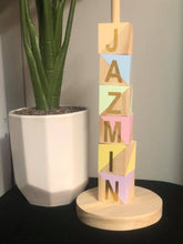 Wooden name stacker
