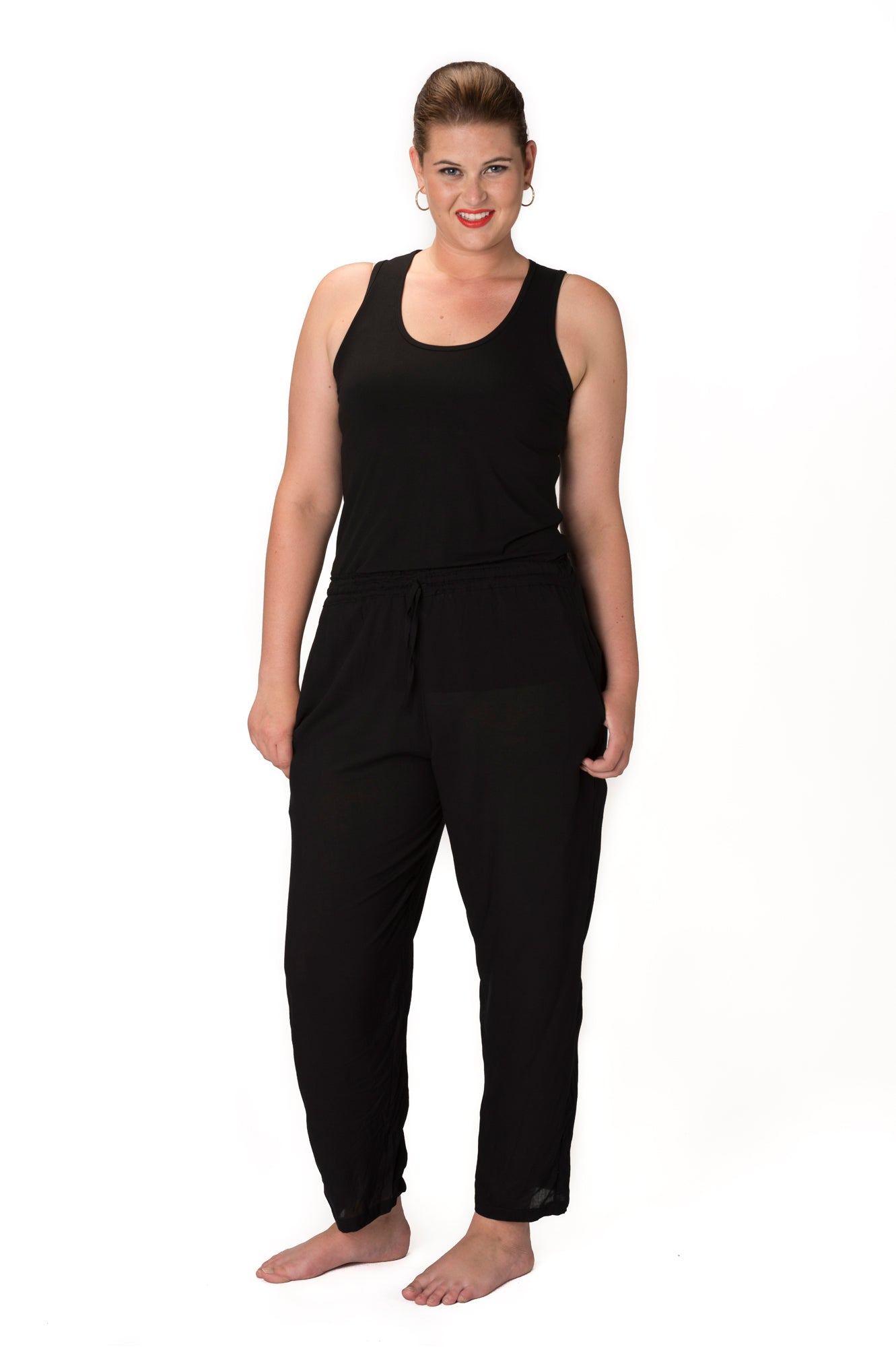Crinkle rayon black tapered leg pant with elastic waist and coin tassel on the tie belt with side pockets