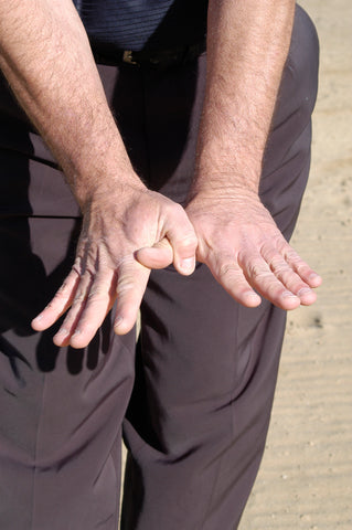 Man with hands spread out and interlocking thumbs