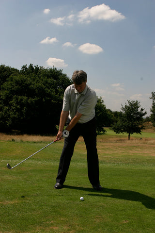 David Wilkinson swinging his golf club back.