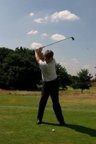 David Wilkinson swinging his golf club back over his shoulder and head.