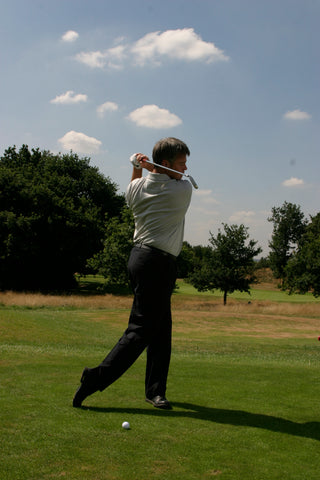 David Wilkinson after hitting a golf ball with golf club over his shoulder