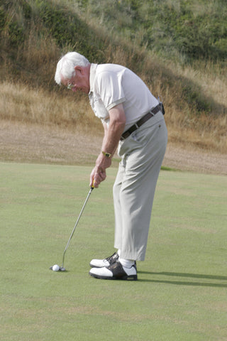 Harold Swash hitting a golf ball