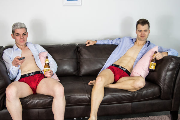 Smugglers Underwear, Boxers and shirts on two Models sat on sofa drinking beers