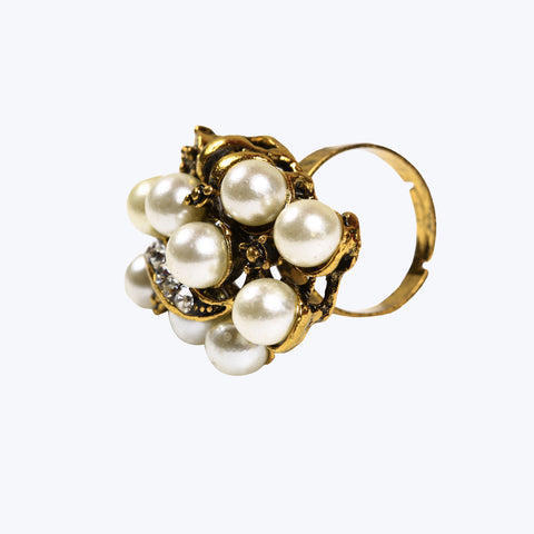 Golden coloured ring designed with pearls