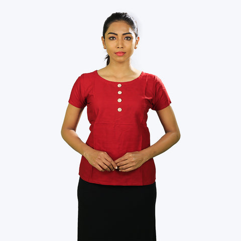 Red colour Top designed with four white buttons