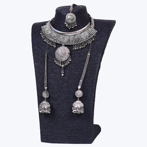 Silver coloured necklace with matching earrings and matha patti