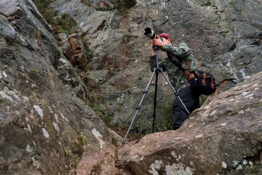 Chris shooting portfolio work with a trail runner on location in Gloucestershire. Chris is wearing the Billingham Hadley Pro 2020 Camera Bag.