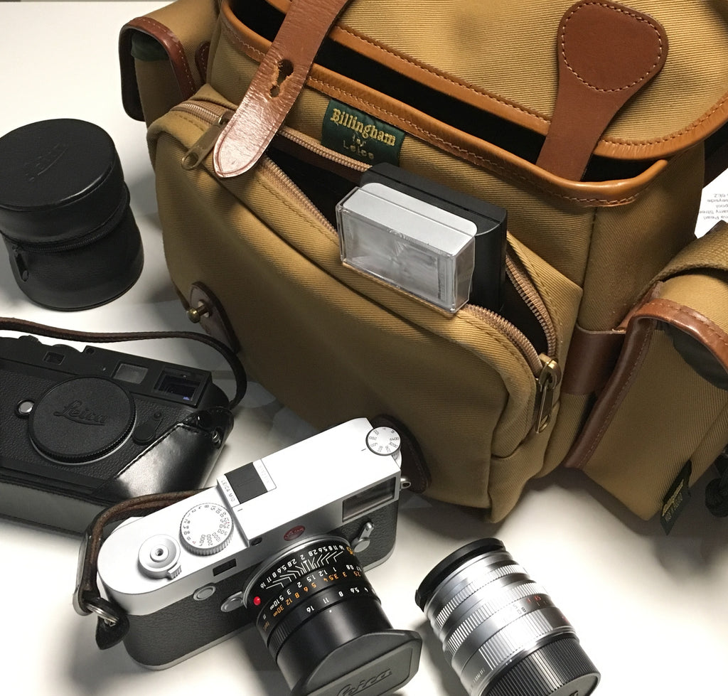 Leica M Combination Bag, with Leica M10, Leica M10 Monochrom, Summicron 35mm , Summicron 50mm along with Leica SF24D flash - Photo by Rena Pearl