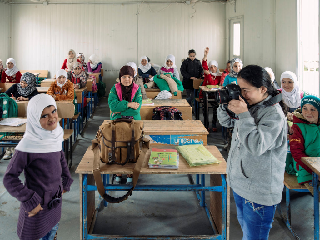 Paddy Dowling holds a photography lesson at school in Zaatari refugee camp for children who have fled Syria. Bag pictured is a Billingham 207.