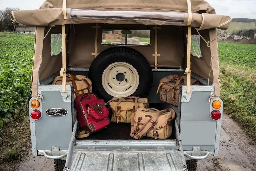 1964 Series 2a Land Rover, Billingham Rucksack 35 in Burgundy Canvas and Chocolate Leather (front left), Billingham Hadley Pro bag (front right), 550 bag, Billingham 225 bag and old Billingham System bag.