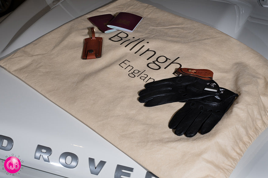Billingham Drawstring bag, Luggage Tally and Key fob on the hood of Land Rover
