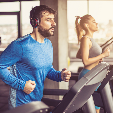 guy and girl running on the treadmill
