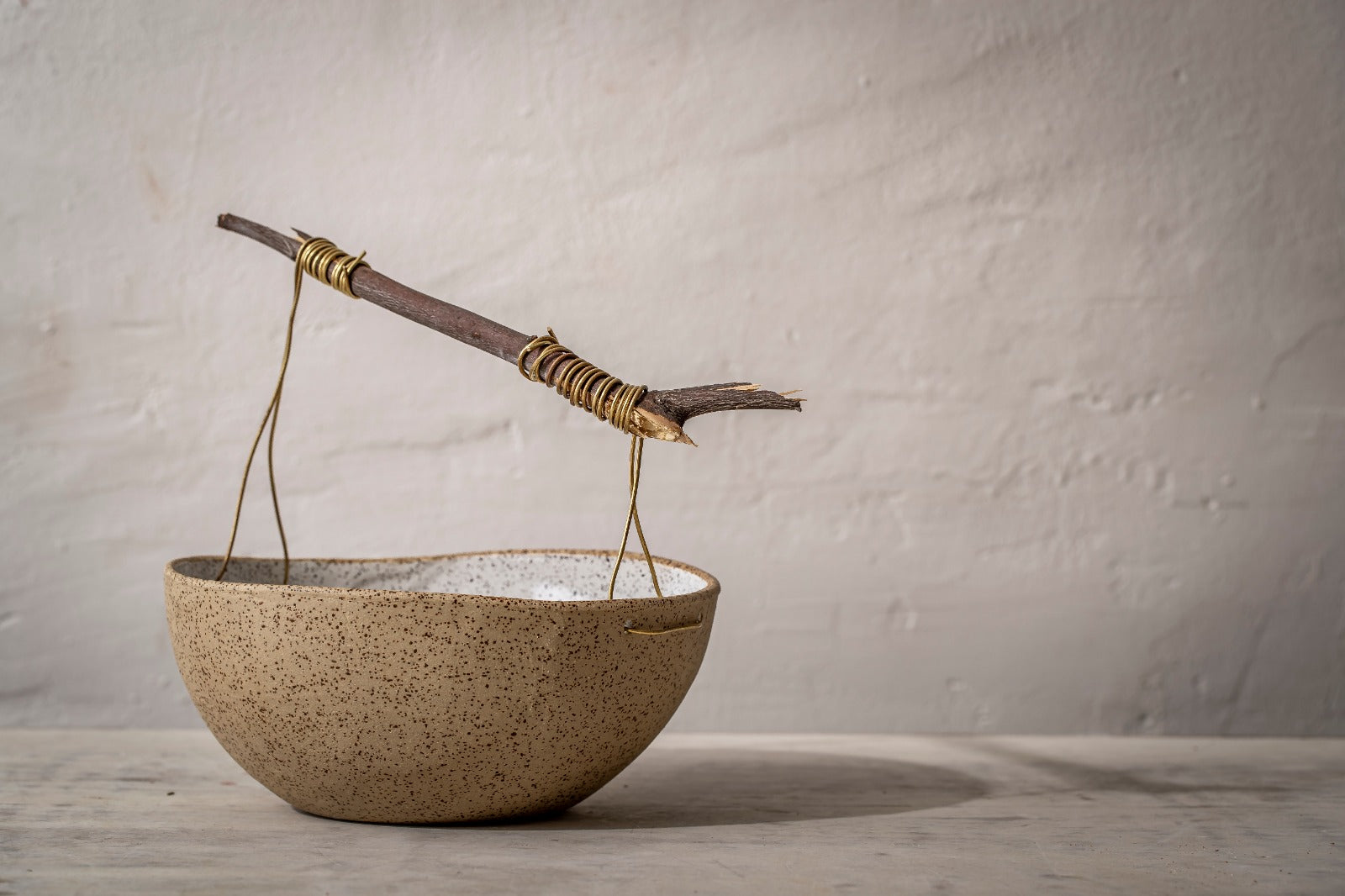 Wooden & brass handle ceramic bowl