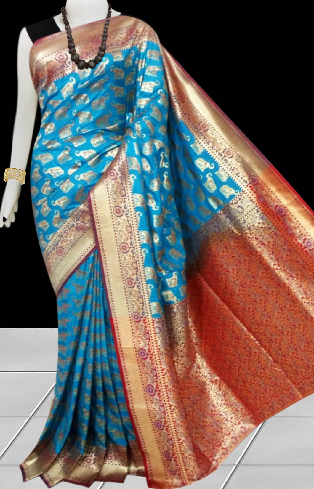 Firozi Color Opara Silk saree, decorated with golden jari work