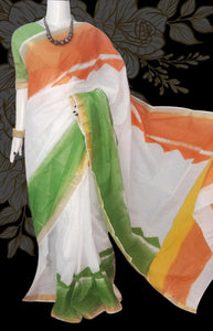 This white  green & orange Kerala cotton saree.