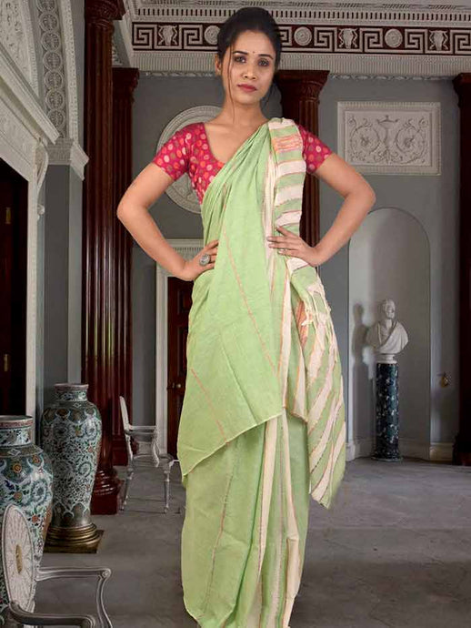 Soothing pista green shantiniketan khesh saree