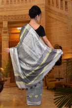 authethic linen saree in grey with woven heart design