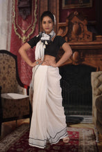 authethic linen saree in white with black lined zari border