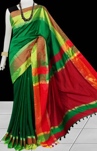 Dark green cotton silk saree with pom-pom work