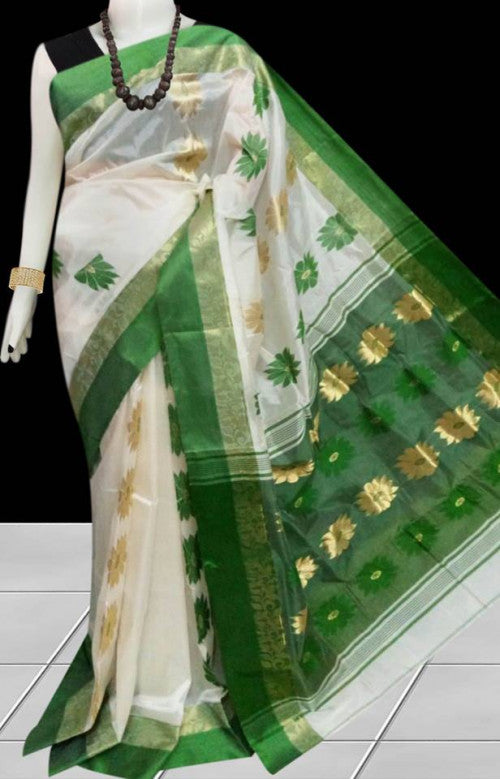 Green & white color tussar silk saree with semi tussar silk threaded, decorated with floral jamdani work