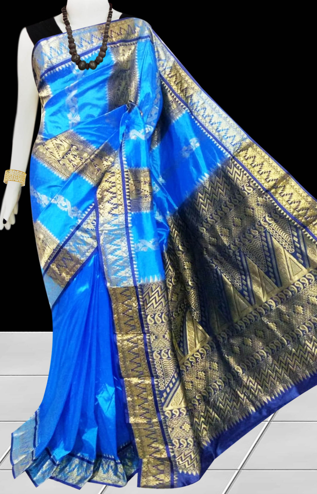 Kanjivaram Silk based saree have combination of blue & golden color