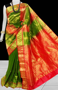 Kanjivaram Silk based saree have combination  of Green & Red color