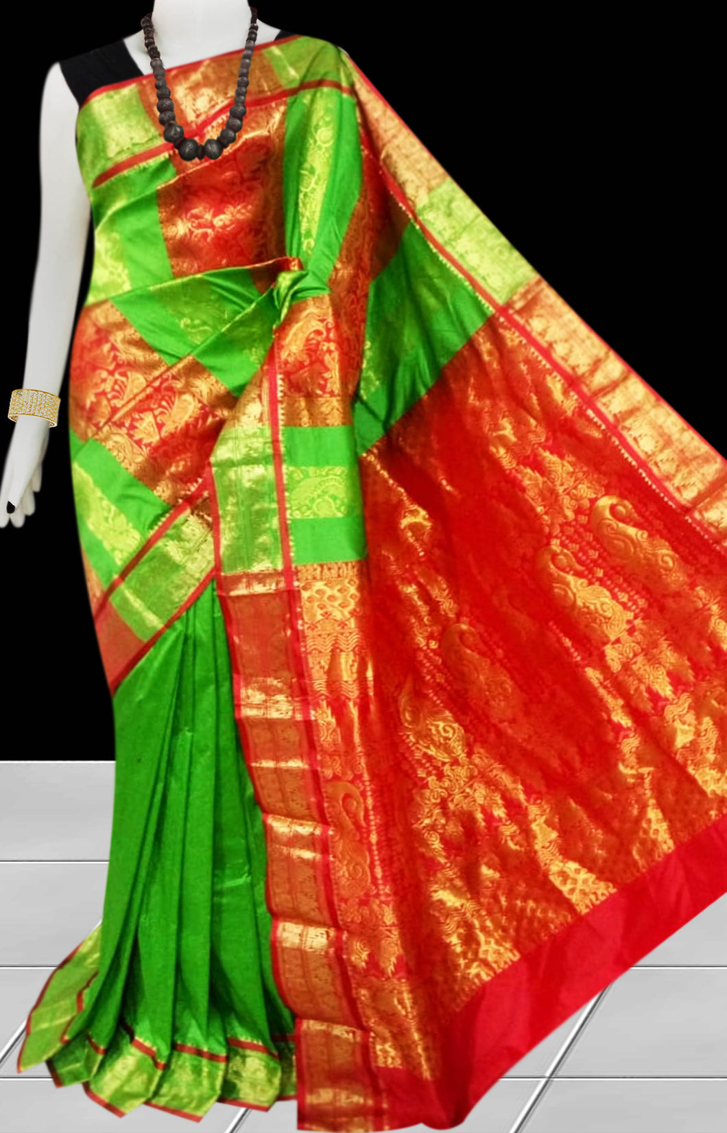 Kanjivaram Silk based saree have combination  of Light Green & Red color