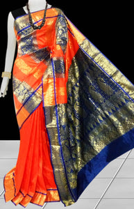Kanjivaram Silk based saree have combination of Orange & Blue color