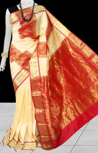 Kanjivaram Silk based saree have combination of Cream & Red color