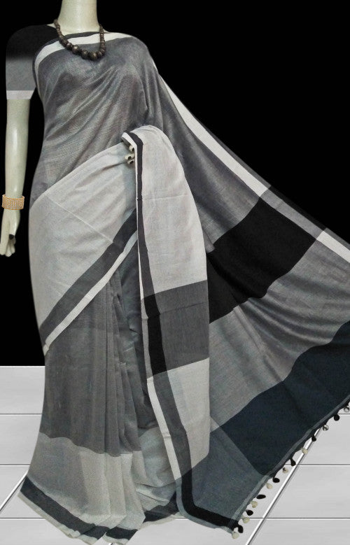 White and grey base cotton silk saree with pom-pom work on pallu