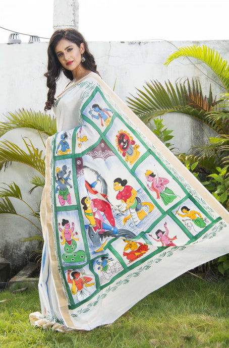 Elegant off-white katan silk with intricate hand painted saree