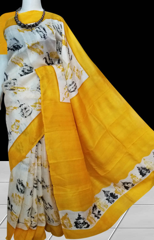 Blazing yellow sonamukhi silk saree with block leaves print