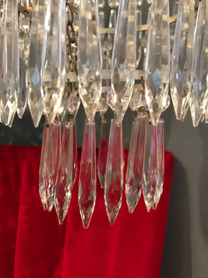 A continental crystal droplet 3 tier chandelier