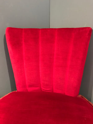 A pair of red velvet oyster shell back boudoir chairs