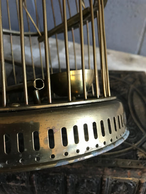 A solid brass bird cage
