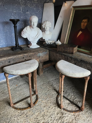 A pair of demilune cast iron and stone tables