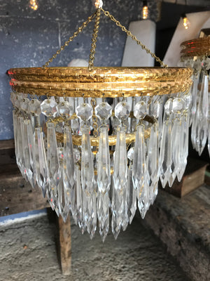 A gilt three tier crystal icicle droplet chandelier