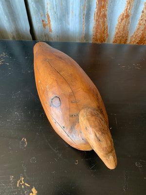 A primitive wooden duck decoy