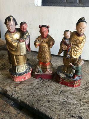 A 19th Century group of three Chinese carved wood and gesso figures