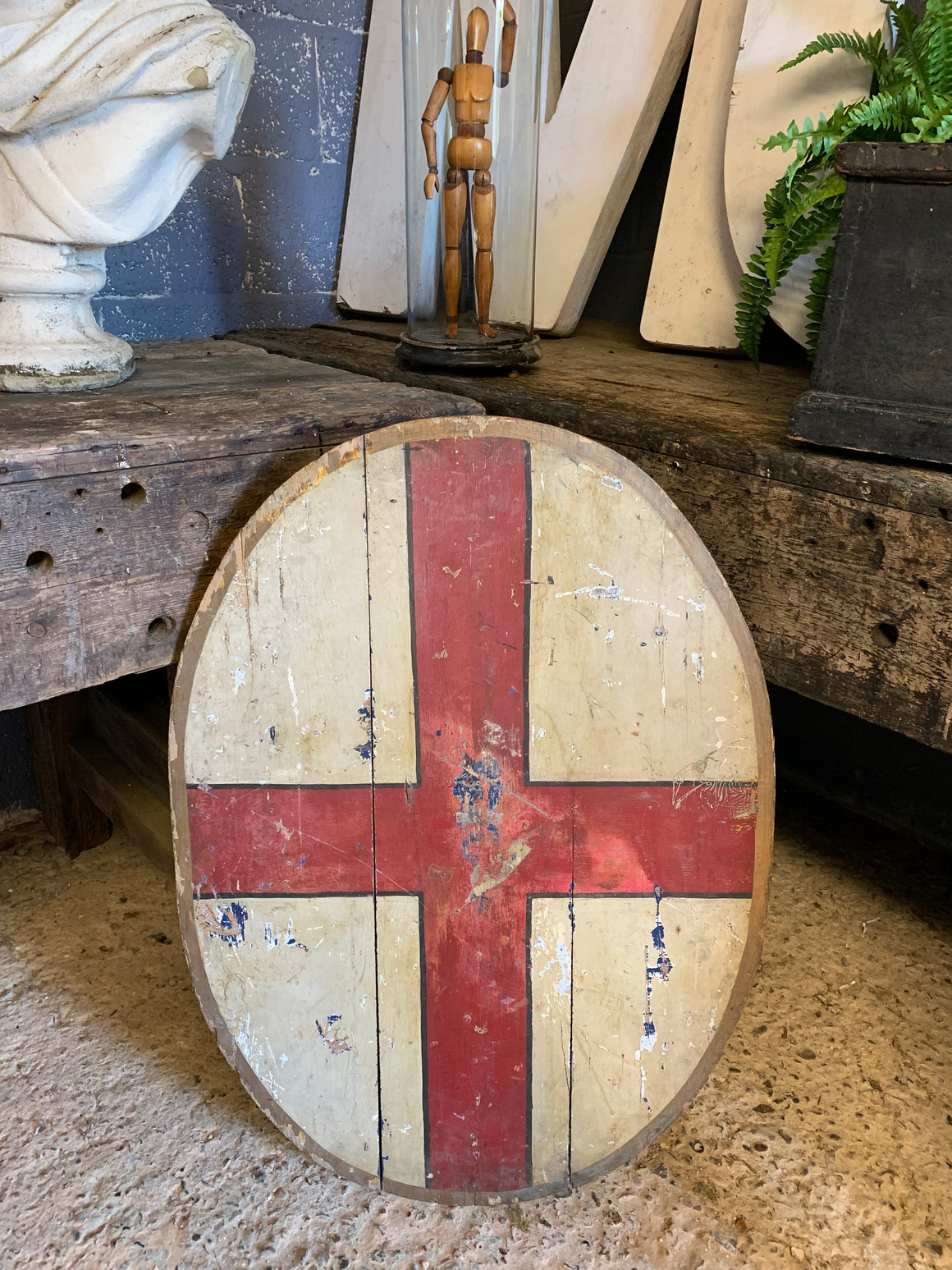 A 19th Century wooden shield for flag display