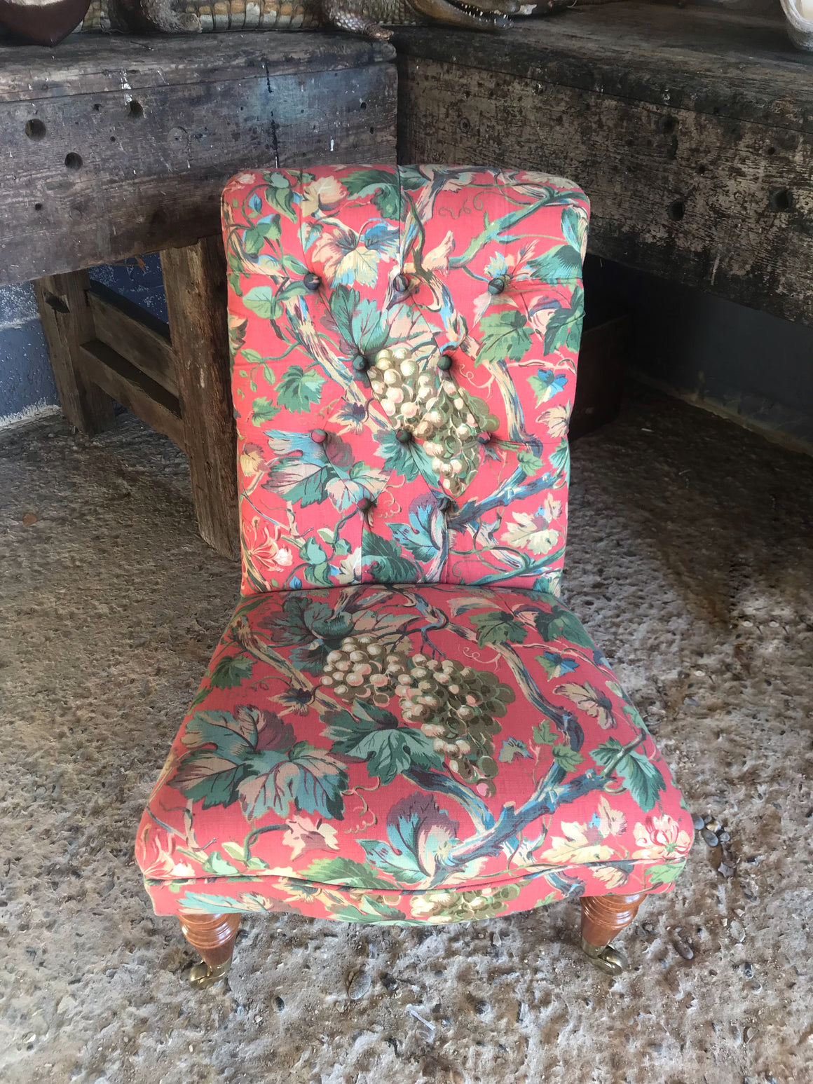 A 'country house' button back nursing chair with brass castors