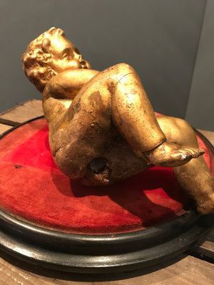 A Large Gilt Wood and Gesso Carved Putto