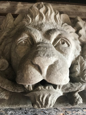 A stone relief plaque of an heraldic lion with oak branch and acorns