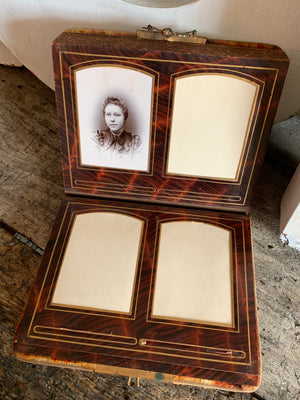 A Victorian cartes de visite photo album with velvet cover and heart-shaped mirror insert