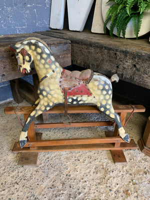 An Edwardian Collinson rocking horse in original condition