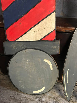 A hand painted barber's pole cut out advertising panel