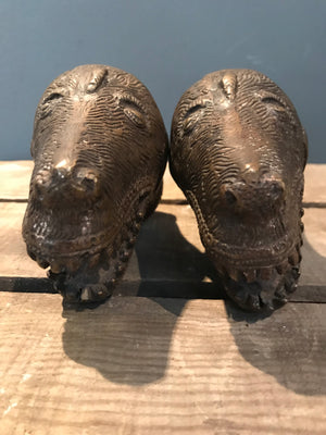 A pair of dog head bronze palanquin finials