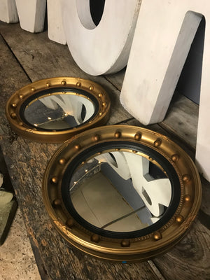 A rare pair of gilt convex Regency ball mirrors